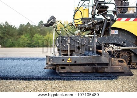 Industrial Pavement Truck Laying Fresh Asphalt On Construction Site, Asphalting .