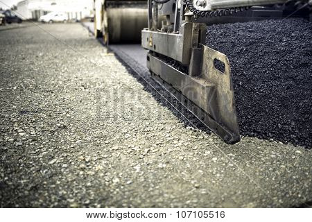 Industrial Pavement Truck Laying Fresh Asphalt, Bitumen During Road Works. Construction Of Highways