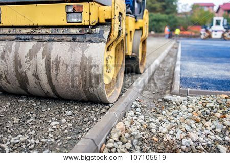 Industrial Compactor, Road Roller On Construction Site. Road Paving And Compacting During High Way C