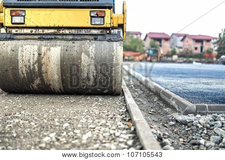 Vibration Roller Compactor At Road Construction And Reparing Asphalt Pavement. Compactor Working On
