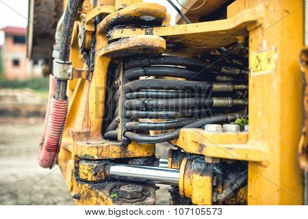Hidraulic Flexible Pressure Pipes And Tubes. Close-up Of Industrial Bulldozer With Oil Leaks