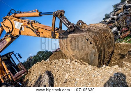 Demolishing Operations At Industrial Construction Site. Worker Using Bulldozer Wrecking