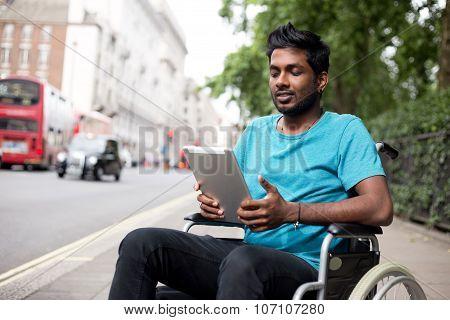 wheelchair man using  tablet