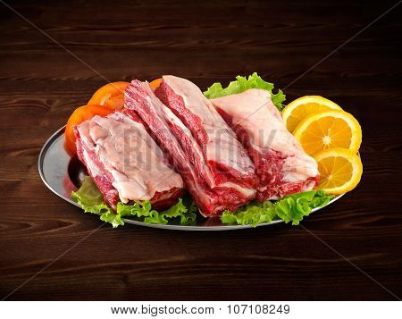 Fresh And Raw Meat. Ribs And Pork Chops Uncooked, Uncut Ready To Grill And Barbecue With Clipping Pa