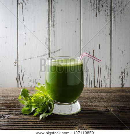 Celery juice on wooden table