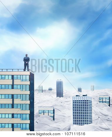 Businessman on the roof is looking at the horizon over the city sinking in paperwork