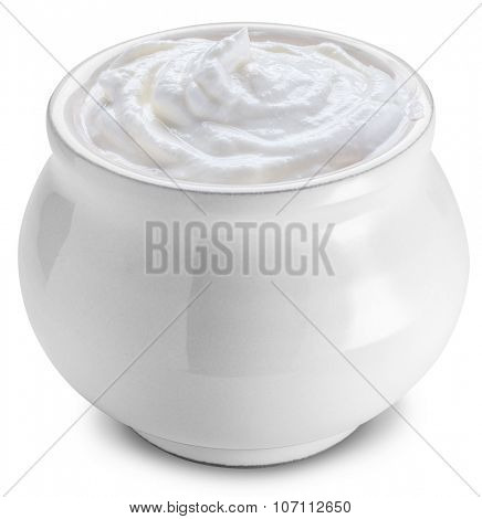 Small ceramic pot with sour cream. File contains clipping paths.