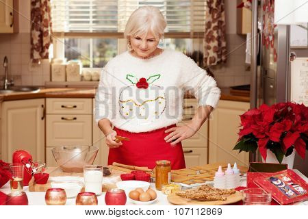 Pretty Grandmother In Kitchen, Christmas Time.