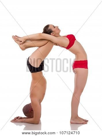 Paired yoga. Bodies of people form figure