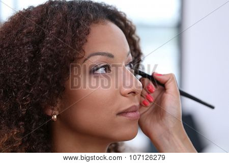 Beauty, skincare. Beautiful woman during make-up