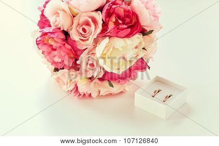people, homosexuality, same-sex marriage and love concept - close up of gay female wedding rings in little box and flower bunch on table