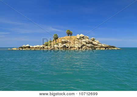 Dry Uninhabited Island And Blue Sky
