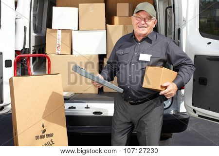 Senior delivery man with parcel near truck. Shipping service.