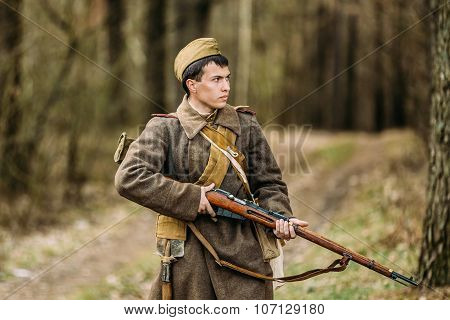 Young unidentified re-enactor dressed as Soviet soldier gunner g
