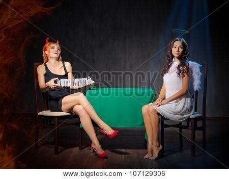 Angel and devil at dark room