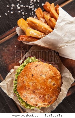Delicious hamburger served on wooden planks. Shot from aerial view