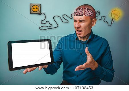 businessman man grimaced and holds in his hand a tablet brain bo