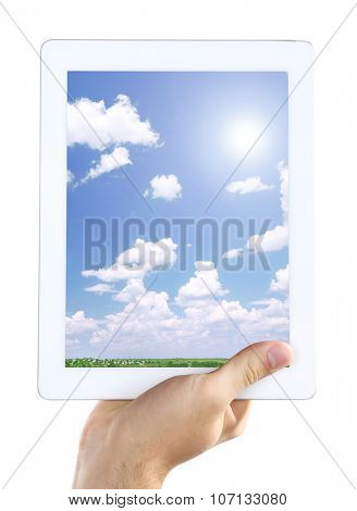 Hand holding tablet PC with sky in screen. Cloud computing concept
