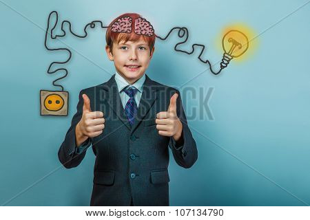 businessman teenage boy showing hand sign yes and smiles chargin