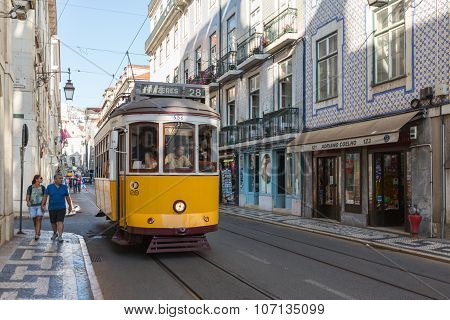 LISBON, PORTUGAL - JULY 12, 2015: Vintage tram in the city center of Lisbon, Portugal.