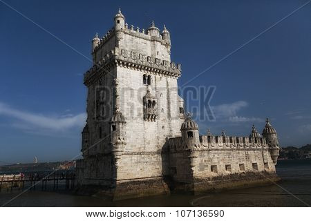 Torre De Belem (belem Tower) On The Tagus River Guarding The Entrance To Lisbon In Portugal.