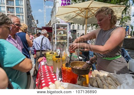 BUDAPEST, HUNGARY - JUNE 03, 2014: Unidentified woman serves food in Budapest.