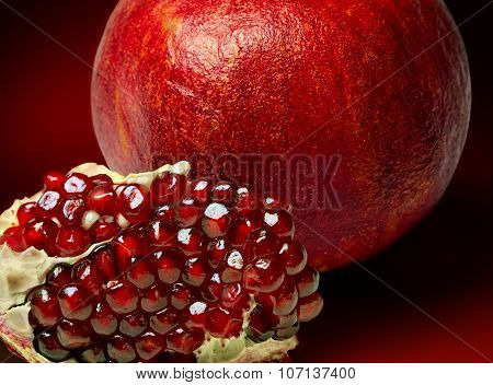 pomegranate fruit on a red background