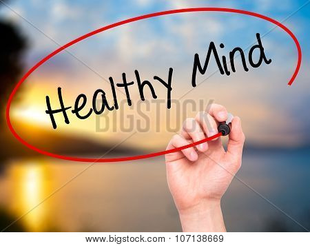 Man Hand writing Healthy Mind with a marker on visual screen.