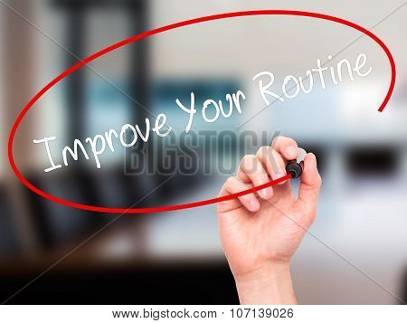 Man Hand writing Improve Your Routine with black marker on visual screen