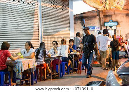 PHUKET, THAILAND - APRIL 26, 2015: Some customers are sitting at the restaurant tables.