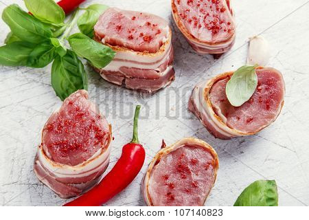 raw Pork tenderloin medallions with bacon wrapped
