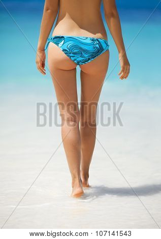 Sexy Woman Buttocks On The Beach Background