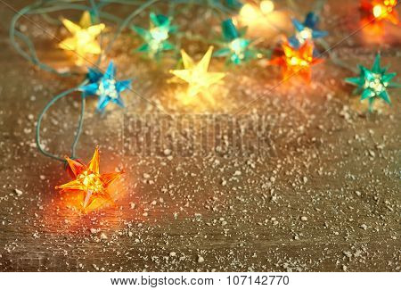 Christmas Star Lights Frame On Wooden Background With Copy Space.