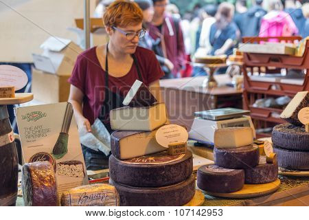 LONDON - JUN 12, 2015: Cheese shop in London. A variety of cheeses for sale at Borough Market.