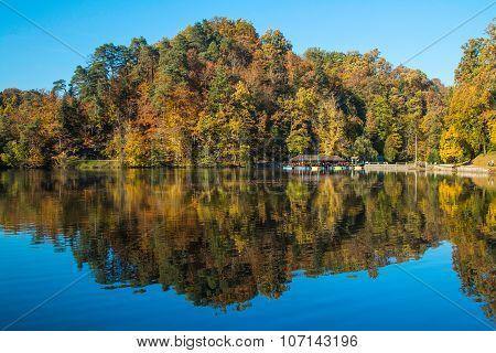 Boat floating on Trakoscan lake in Zagorje, Croatia, season, autumn, Reflection of trees on water