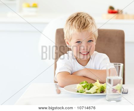 Portrait Of A Little Boy Eating A Healthy Salad For Lunch