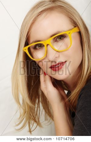 Woman With Yellow Glasses.