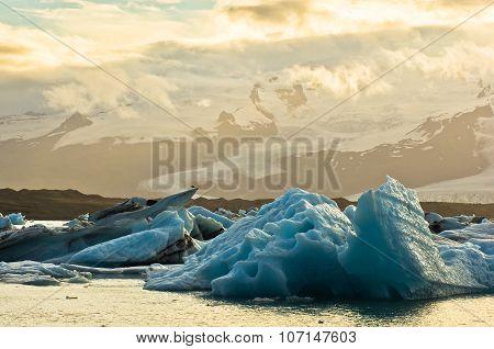 Melting of icebergs in Jokulsarlon glacier lagoon at sunset