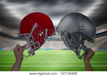 American football player handing his helmet against rugby stadium