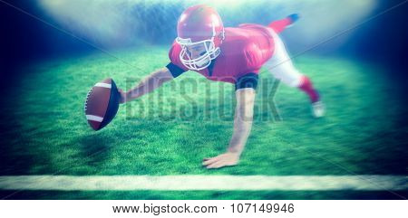 American football player reaching football against rugby pitch