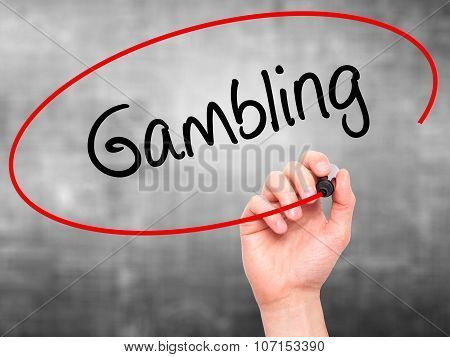 Man Hand writing Gambling with black marker on visual screen.