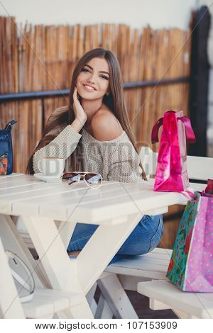 Charming woman in a cafe for a cup of coffee