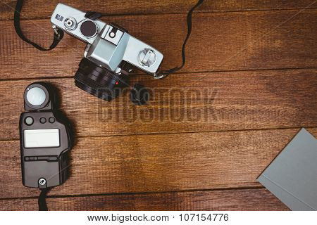 View of an old camera with photo flash on wood desk