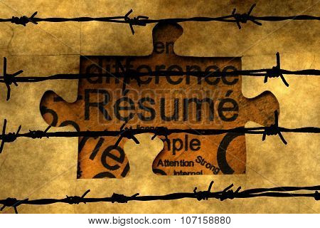 Resume Puzzle Concept Against Barbwire