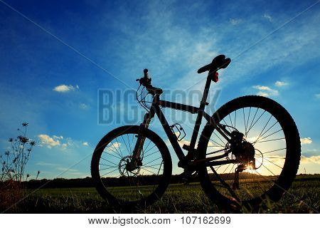 Silhouette of Mountain bicycle at sunset