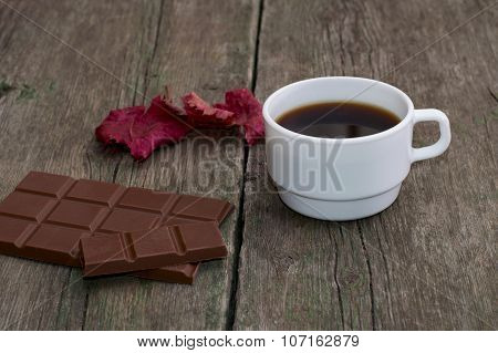 White Cup Of Coffee, Chocolate And Red Leaf