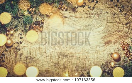 Christmas branch with decoration on wood background