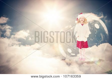 Festive child in snow globe against sky