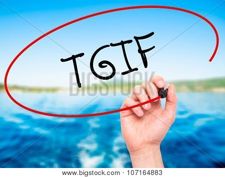 Man Hand writing TGIF with black marker on visual screen.