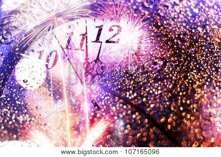 New Year's at midnight - clock and fireworks